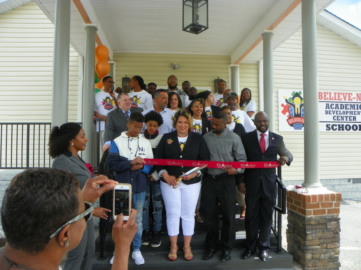 Surrounded-by-her-family-staff-and-well-wishers-Demetria-R.-Jennings-performs-ribbon-cutting-officially-opening-the-new-Believe-N-U-Child-Development-Center[1]